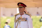 Defence chief in formal white military uniform