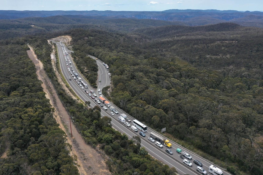 Traffic banked up with a line of cars and trucks stretching into the distance