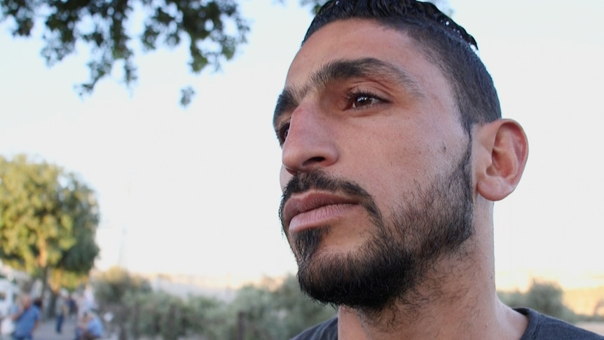 Ahmad, 25, has to spend hours each day passing through a West Bank checkpoint in order to get to work in Jerusalem.