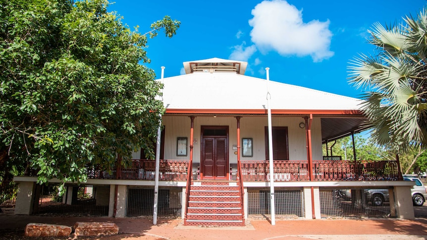 A modest country courthouse, raised off the ground in the fashion of a Queenslander house.