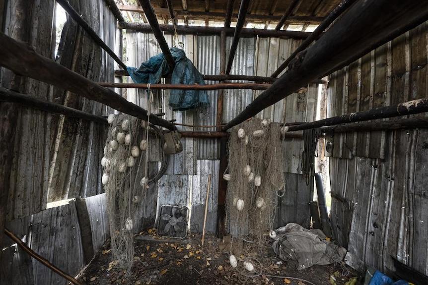 Salmon nets hang inside a smokehouse in Alaska