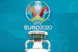 A logo of Euro 2020 is shown with the top of a silver trophy in the foreground