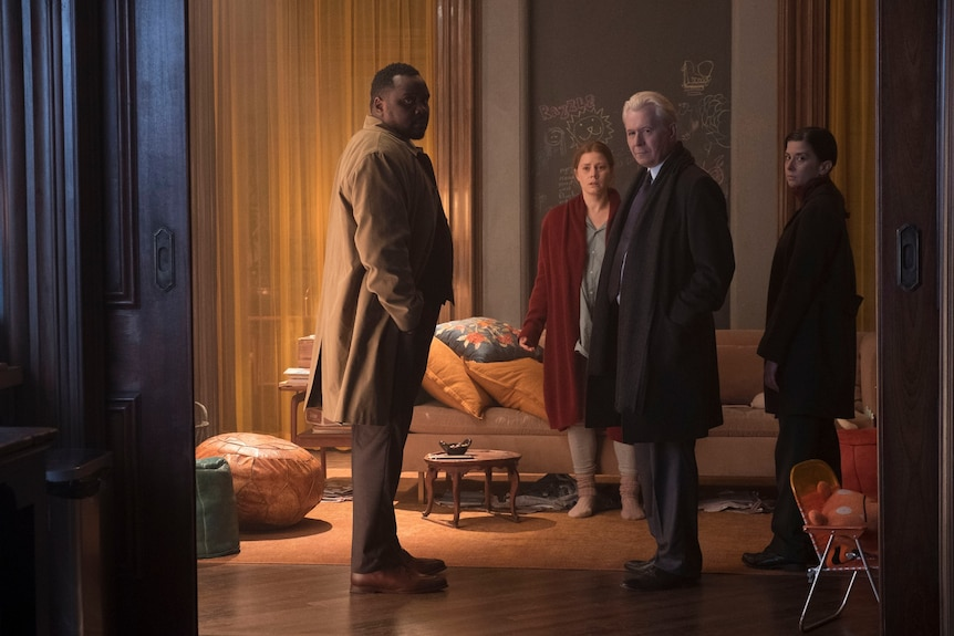 Film still of Brian Tyree Henry, Amy Adams, Gary Oldman and Jeanine Serralles facing the camera in The Woman in the Window
