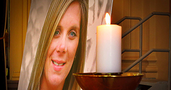 Tara Costigan's photo with a candle at her funeral.