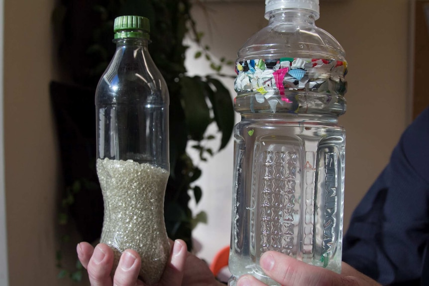 Two bottles containing recycled plastic beads and floating plastic bits