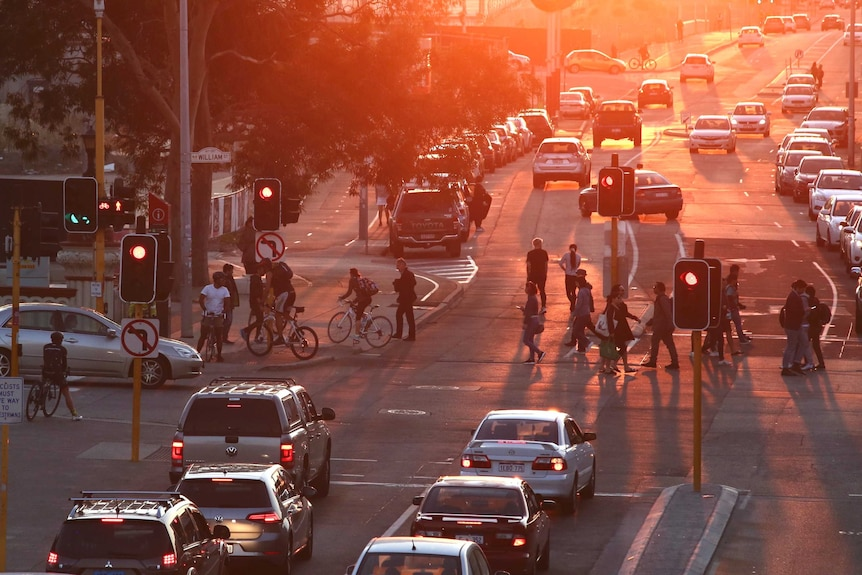 As the sun sets on Roe St, cars, bicycles and pedestrians filled the road and footpaths.