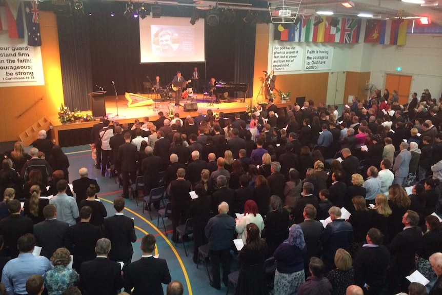 Mourners gather at the funeral of MH17 victim Victor Oreshkin in Sydney's south west.
