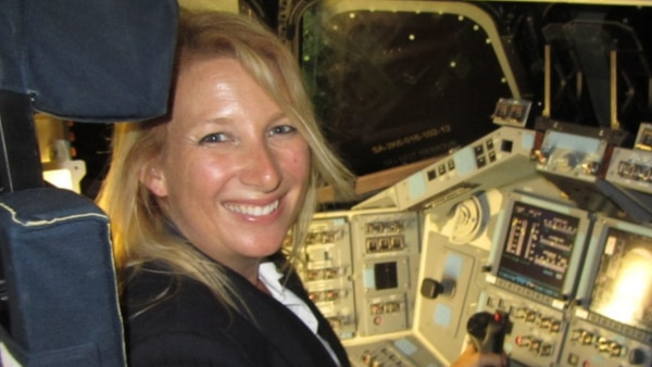 Kim Ellis Hayes sitting in the captain's seat of the NASA's Space Shuttle Endeavour