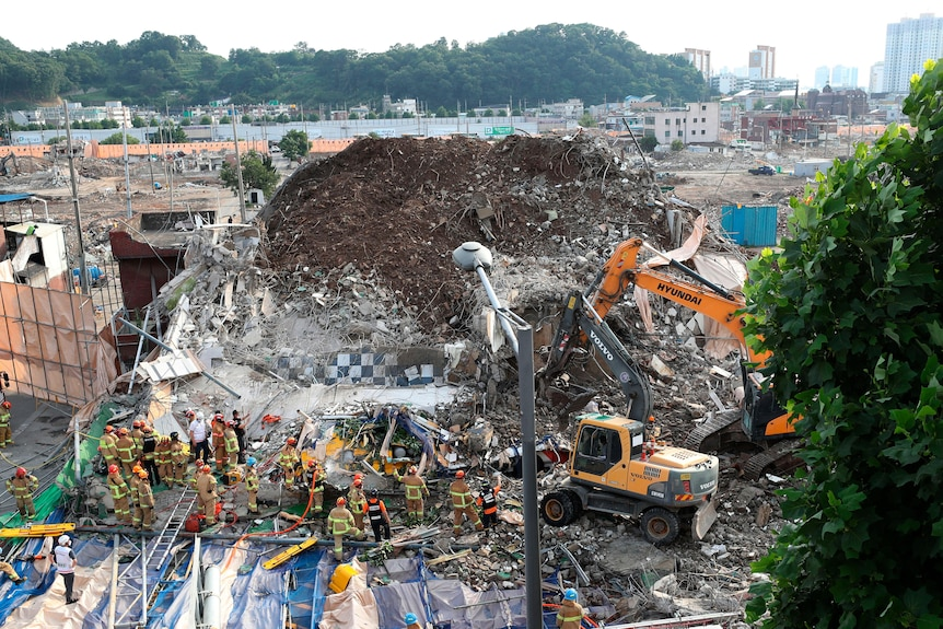 Firefighters search for survivors following a collapsed building in Gwangju, South Korea