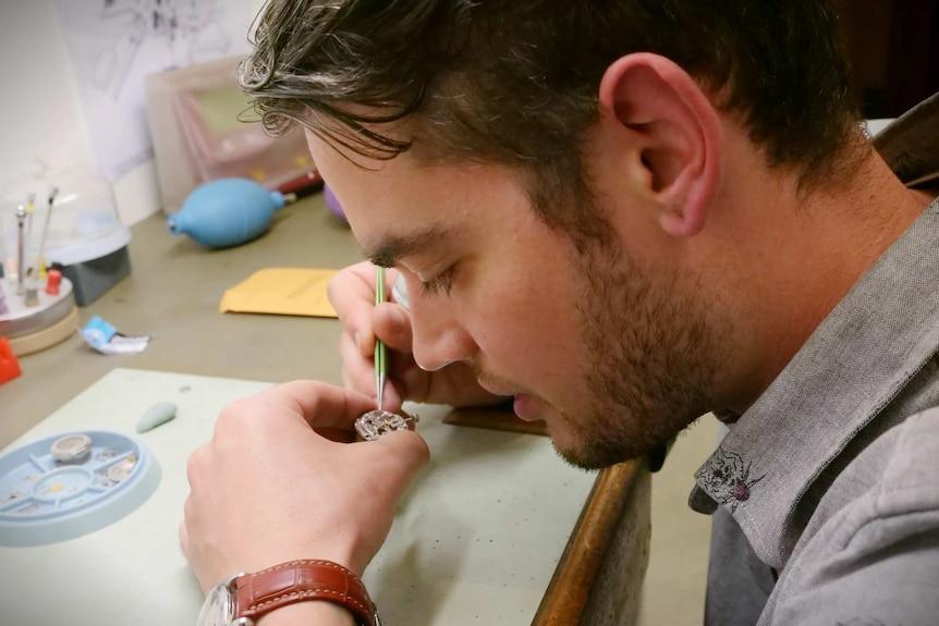 Tim Stewart repairs a watch
