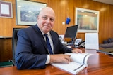 Victorian Treasurer Tim Pallas with the State Government's 2018 budget.