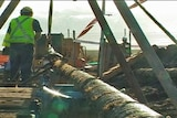 Worker helps lay Basslink cable