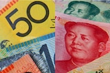 LtoR Australian dollar notes and Chinese Yuan.