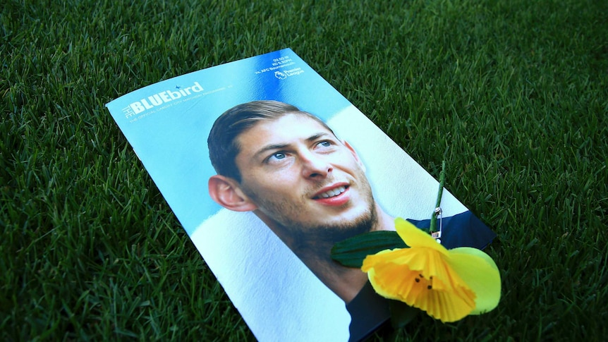 Sala's face on the cover of the Cardiff City magazine, with a yellow flower on top