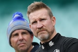 The Collingwood AFL coach pictured standing with his two sons at the SCG.