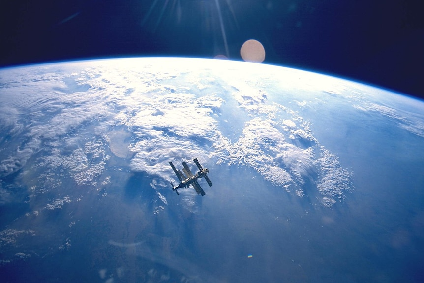 Mir Space Station with Earth in the background.