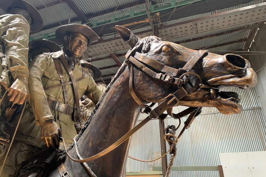 A bronze statue of 'Bill the Bastard' and his rider Michael Shanahan shows the horse with an open mouth