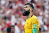 Mile Jedinak looks on after loss to Peru