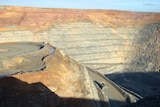 Close up of Super pit in Kalgoorlie from edge with truck driving along