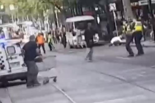 A man pushes a shopping trolley towards Bourke Street terrorist Hassan Khalif Shire Ali.