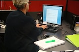 Office worker sitting at a computer