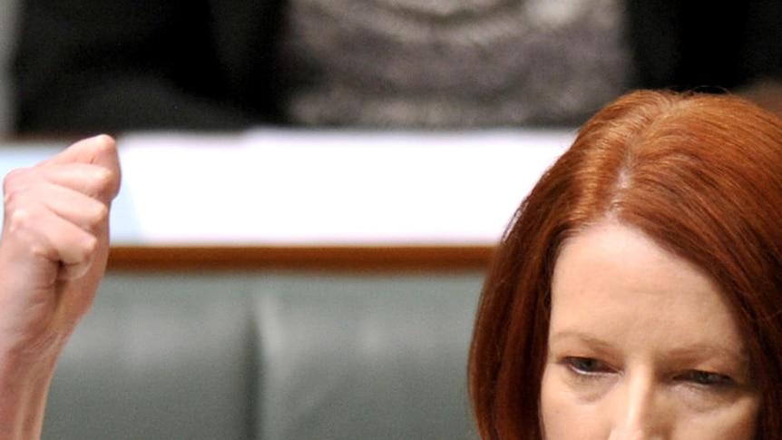 Gillard raises fist in question time