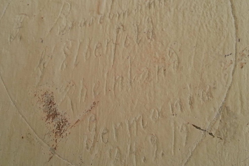 Graffiti inside solitary confinement cells at German internment camp at Holsworthy, 1917