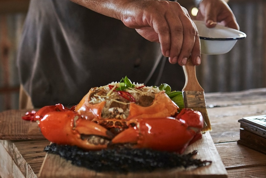 Warwick Thornton prepares a crab meal he cooked in The Beach documentary.