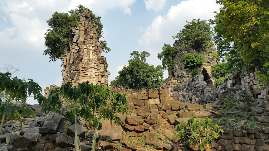 The ruins of Preah Khan of Kompong Svay covered with forest