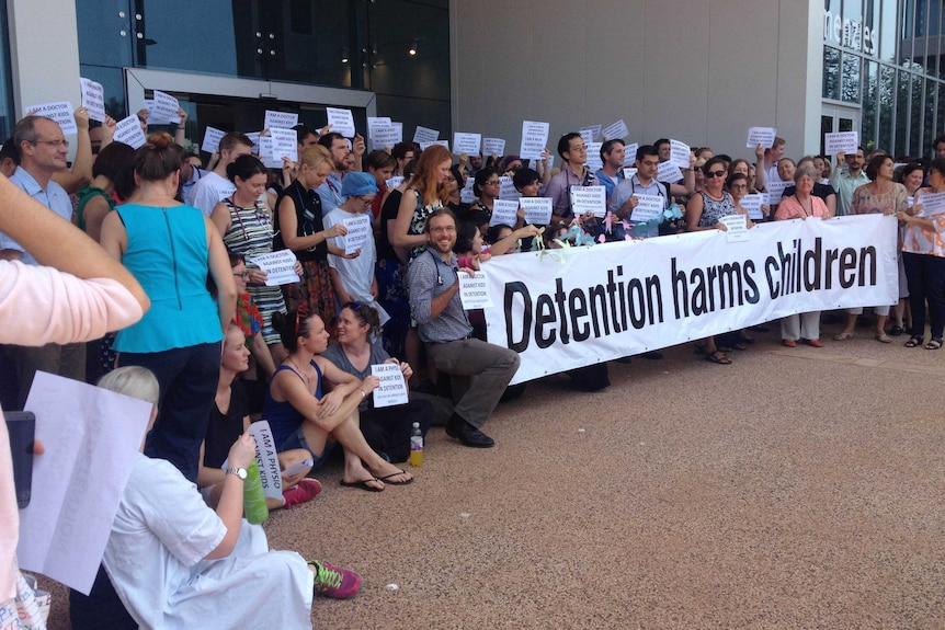 Around 200 doctors, nurses and other health workers gathered outside Royal Darwin Hospital to join the protest over kids in detention