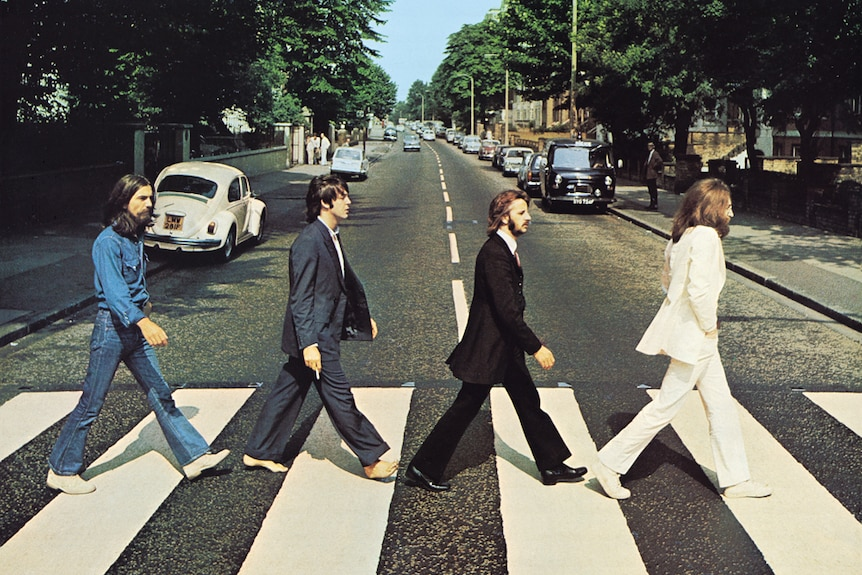 The iconic album cover of Abbey Road by the Beatles