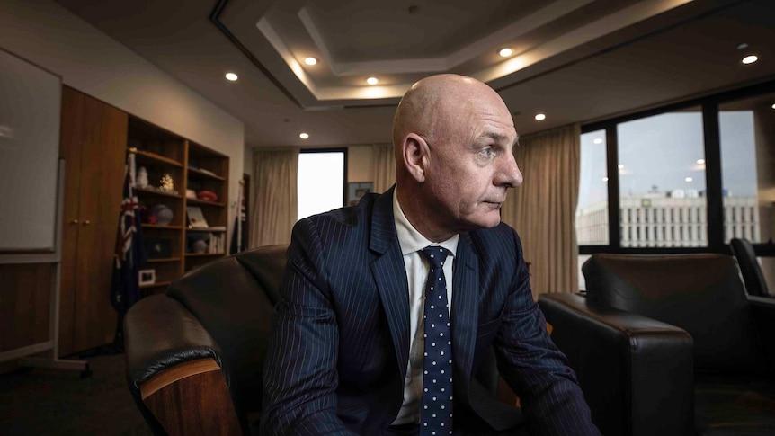 Tasmanian Premier Peter Gutwein looks out a window