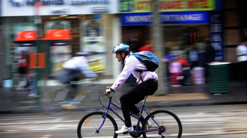 A cyclist makes his way to work