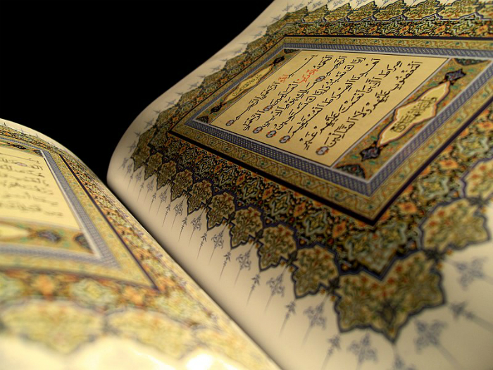 A page of the Quran open.