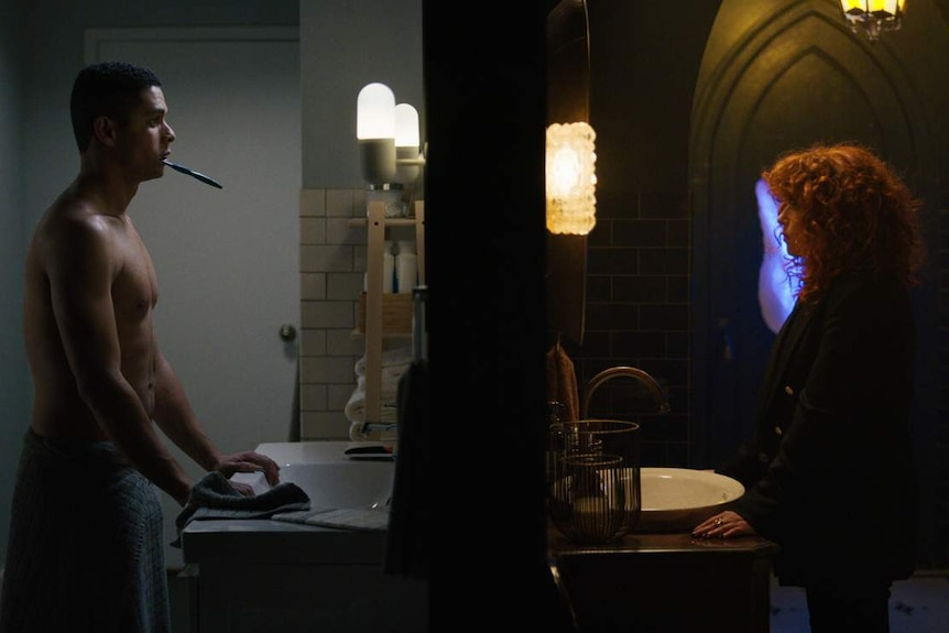 Split-screen still featuring two bathrooms: one minimalist with man brushing teeth, another grungy with woman staring in mirror.
