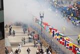 Smoke rises from the blast on the Boston marathon route.