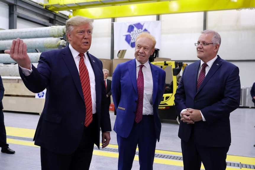 Donald Trump speaks while Scott Morrison and Anthony Pratt watch him