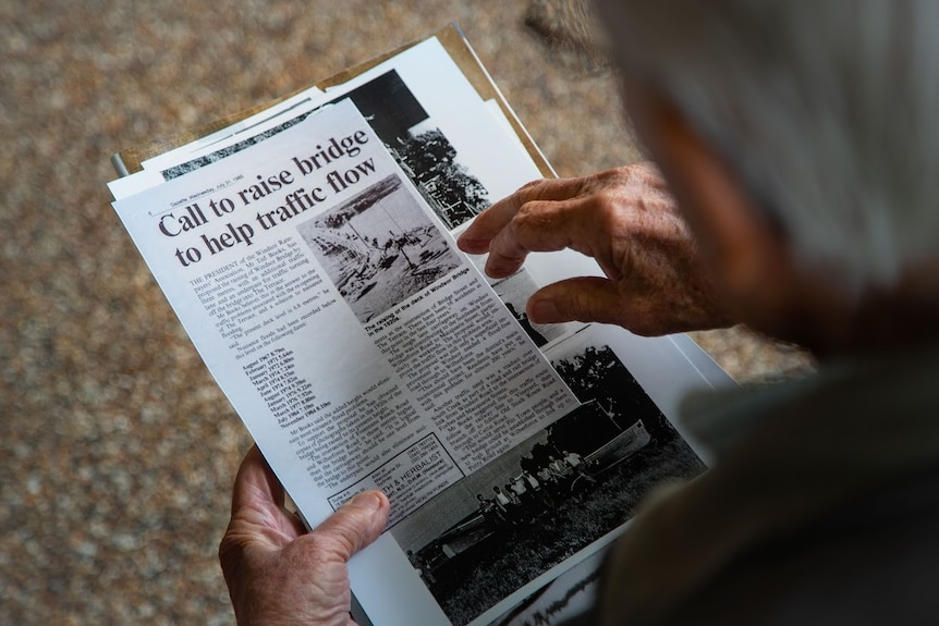 Ted Books reads an old newspaper clipping about the floods.