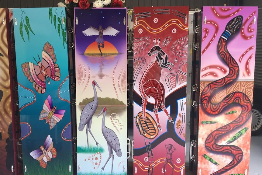 Coffins for Aboriginal funerals decorated with indigenous designs