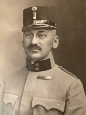 Dr. Siegmund Defris appears in black and white wearing a German military uniform from WWI.