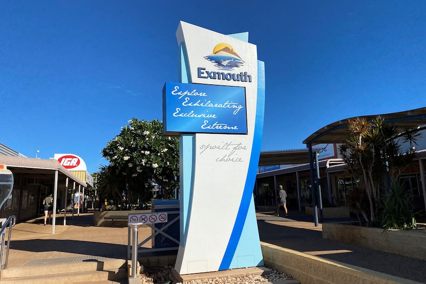 A large sign showing the Exmouth Shire logo, located in the town's centre.