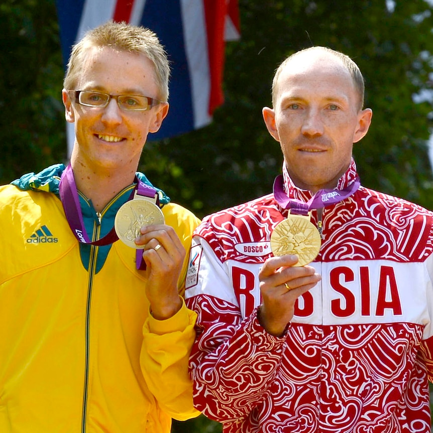Jared Tallent and Sergey Kirdyapkin hold their medals on the podium at the London Olympic Games.