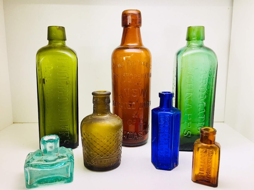 A collection of antique coloured bottles.