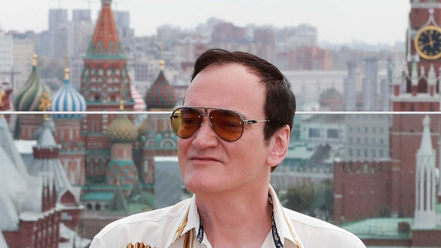 A man poses in front of Red Square