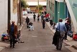 Homeless men gather in the laneway outside a men's hostel Matthew Talbot House in Kings Cross.