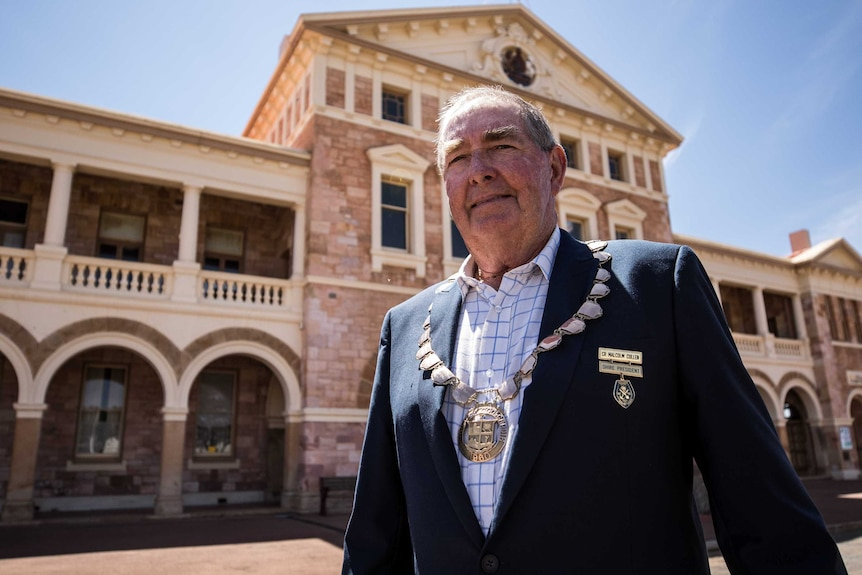 The president of a local council in regional WA standing on the main street of his historic mining town.