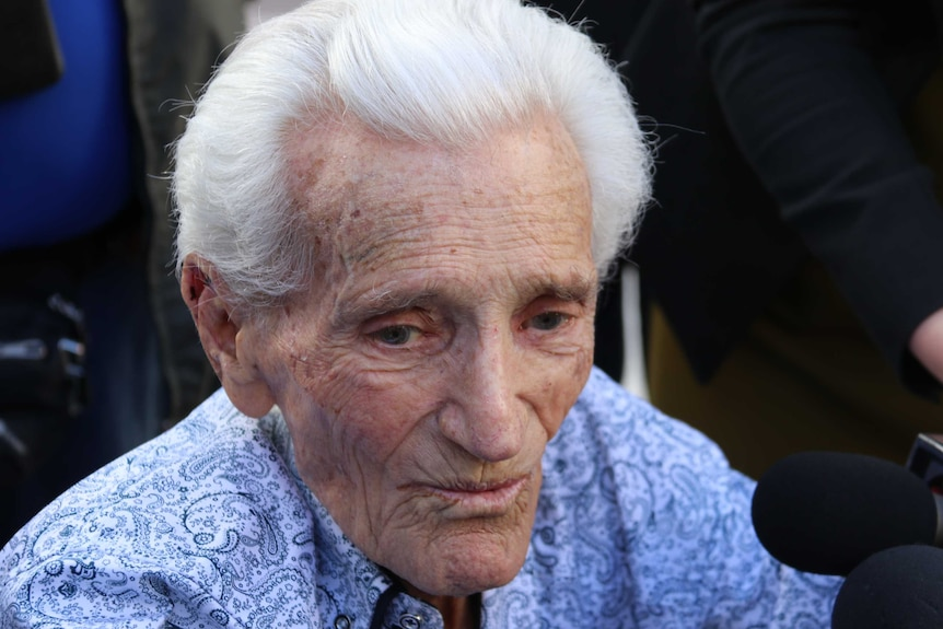 Close-up of the face of a man with white hair