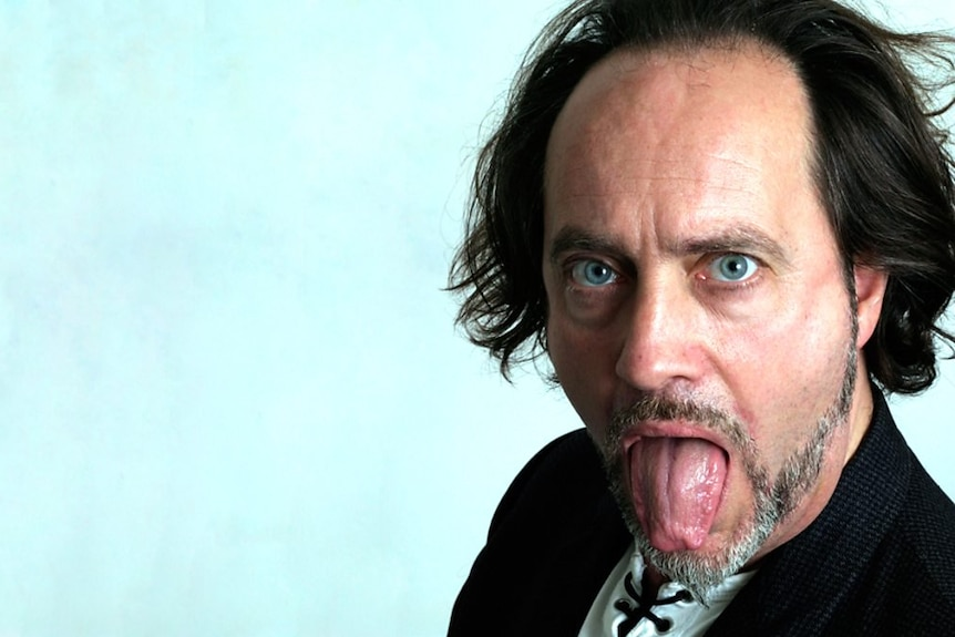 A head shot Ian Cognito with his tongue out