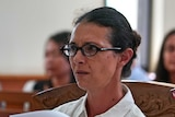 Close up of Sara Connor wearing glasses during her court appearance in Bali.