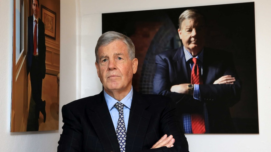 David Leckie stands in front of his portrait at Sydney's Machiavelli restaurant.
